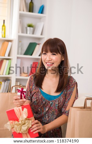 happy asian girl with her gift and shopping bags