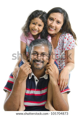 Happy Asian Indian family stacking on white background