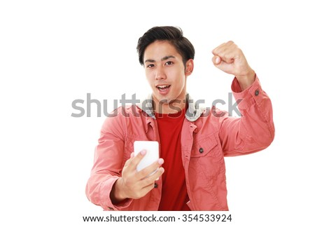 Happy Asian man holding a smart phone