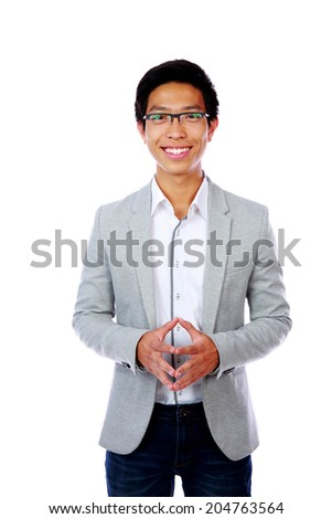 Happy asian man standing over white background - stock photo