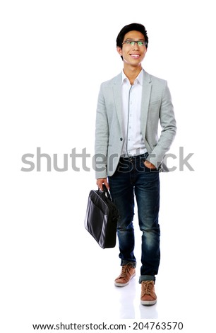 Happy asian man walking with briefcase over white background - stock photo