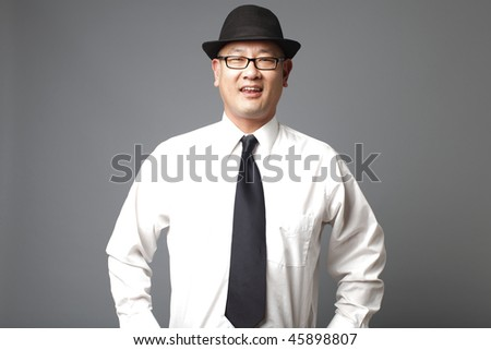 Happy asian man wearing a fedora.