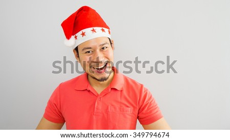 Happy asian man with Santa Claus hat.