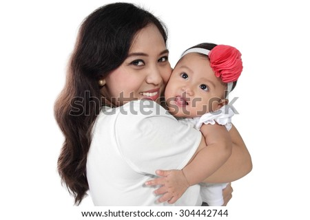 Happy Asian mother hugging her cute baby daughter, isolated on white background - stock photo