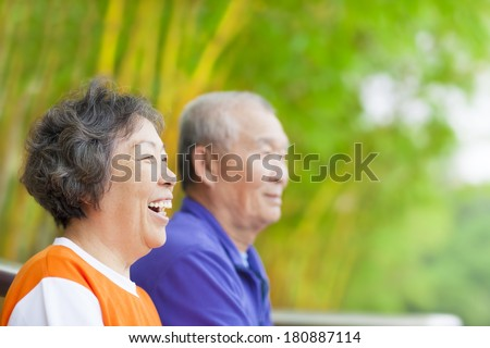 happy asian seniors in the park - stock photo