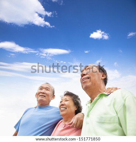 happy asian seniors standing together