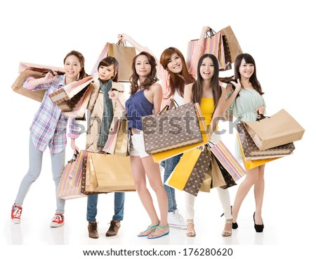 Happy Asian shopping girls on white background. - stock photo