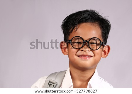 Happy Asian student boy wearing glasses with big smile on his face