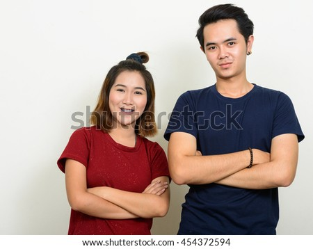 Happy Asian teenage couple - stock photo