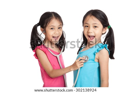 Happy Asian twins girls with stethoscope  isolated on white background
