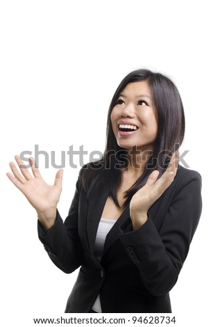 Happy Asian woman looking up and arms out, isolated on white. - stock photo