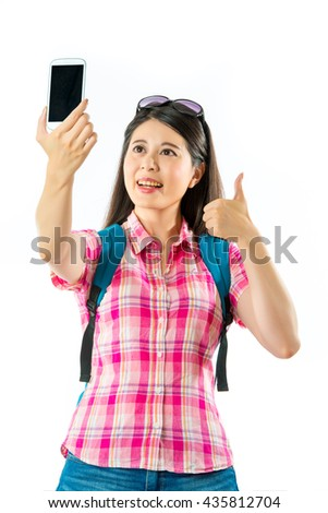 Happy asian woman tourist taking selfie and thumb up on white background
