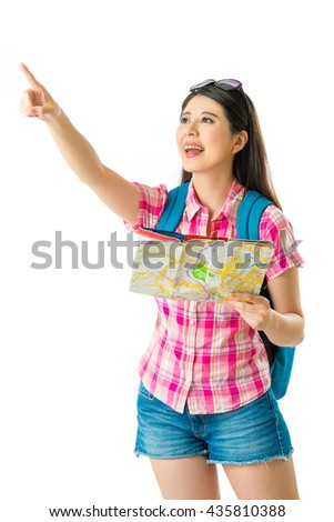 Happy asian woman tourist with pointing gesturing on white background - stock photo