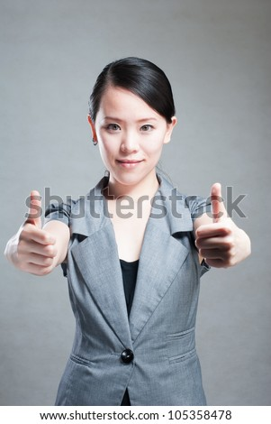 Happy Asian woman with her arms in the air cheering - stock photo