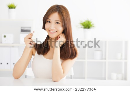 happy asian young drinking coffee - stock photo