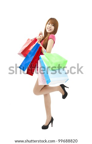 happy asian young woman with shopping bags