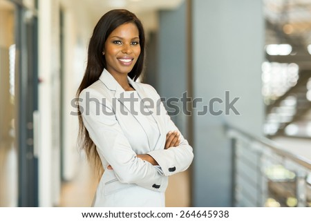 happy attractive african american businesswoman in office - stock photo