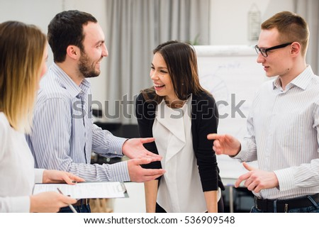 Happy attractive business group standing in an office