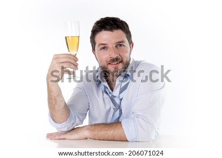 Happy attractive Business man drinking Champagne holding glass wearing blue shirt with a loose tie celebrating  a very busy successful work project isolated on white background - stock photo