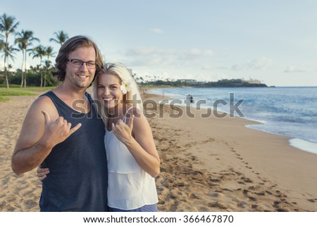 Happy Attractive Couple on a Hawaiian Beach Vacation - stock photo