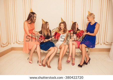 Happy attractive girls celebrating birthday party - stock photo