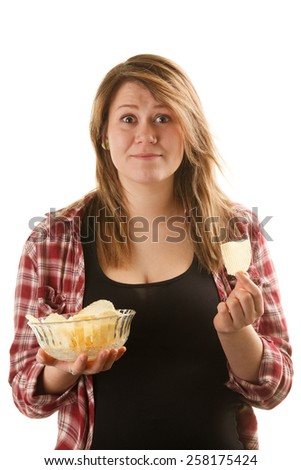 Happy, attractive woman holding a bowl of potato chips - stock photo