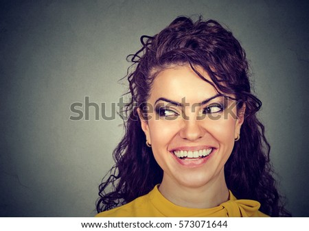 Happy attractive woman smiling looking to the side