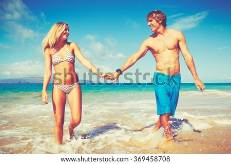 Happy Attractive Young Couple on Tropical Beach