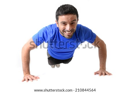 happy attractive young sport man training hard his body doing push up exercise isolated on white background - stock photo