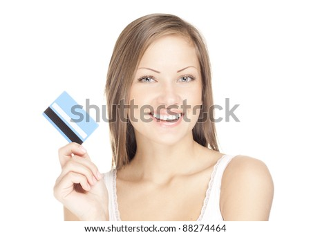 happy attractive young woman holds credit card - stock photo