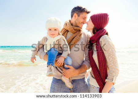 happy autumn fall family on coast enjoying togetherness