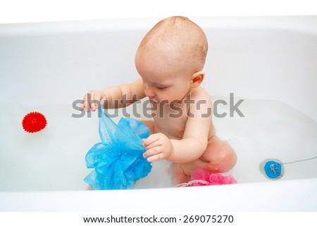 happy baby bathing in bathtub - stock photo