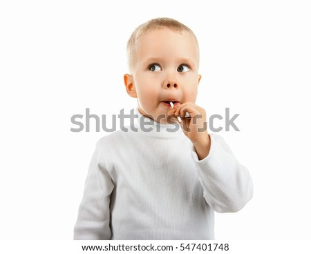 happy baby boy eating candy Lollipop, on a white background