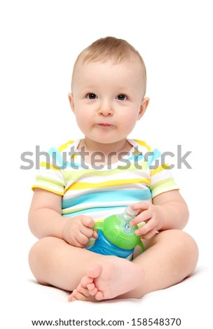 happy baby boy holding milk bottle