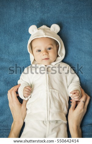 Happy baby boy in funny white bear costume