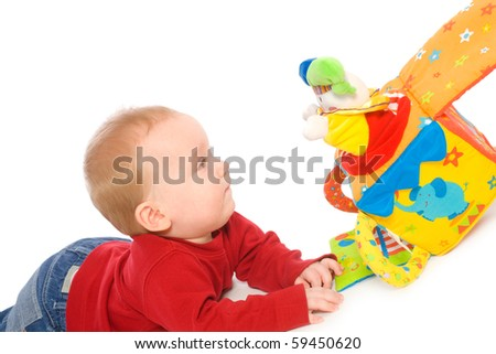 Happy baby boy (6 months old) playing with soft toys, smiling. Toys are property released. - stock photo