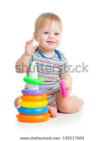 happy baby boy playing with colorful toy isolated on white - stock photo