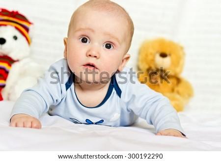Happy baby boy portrait with teddy bears - stock photo