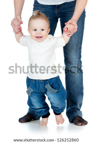 happy baby boy steps first time isolated - stock photo