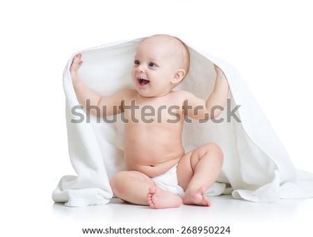 happy baby boy under towel after bath - stock photo