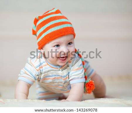 happy baby boy weared in hat - stock photo