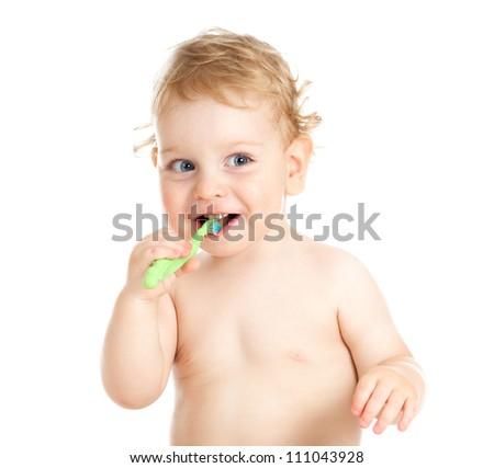 Happy baby child brushing teeth - stock photo