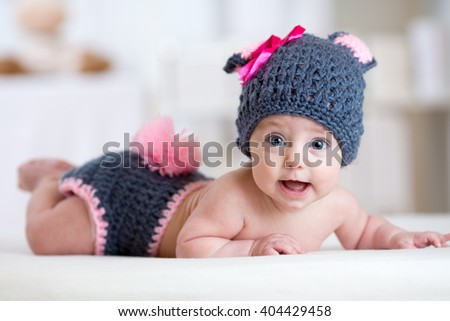happy baby child in costume a rabbit bunny at home - stock photo