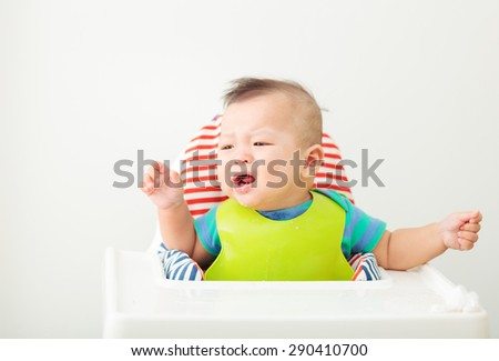 happy baby child sitting in chair - stock photo