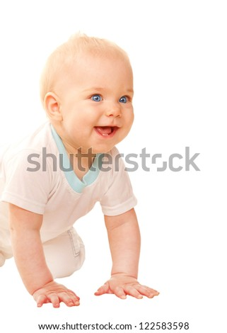 Happy baby crawling, looking out and smiling.  Isolated on white background. - stock photo