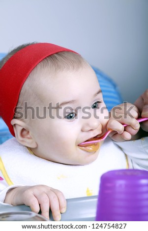 Happy baby eat with spoon