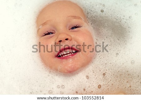 happy baby face in bubble bath - stock photo