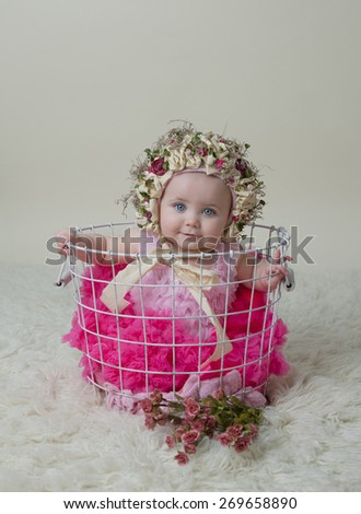 Happy Baby Girl In Basket Wearing Hat - stock photo