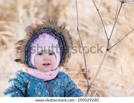 happy baby girl on snow - stock photo