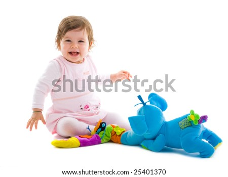 Happy baby girl sitting on floor playing with toy smiling, cotout on white background. - stock photo